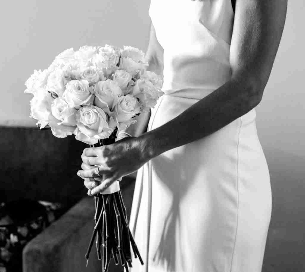 A woman on her wedding day holding flowers